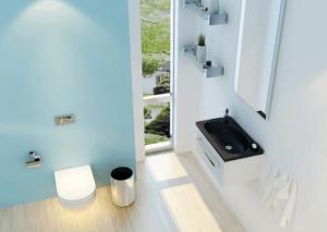 Smukt lyst badeværelse med en af KKP Interiørs badeværelsesvaske i skandinavisk design