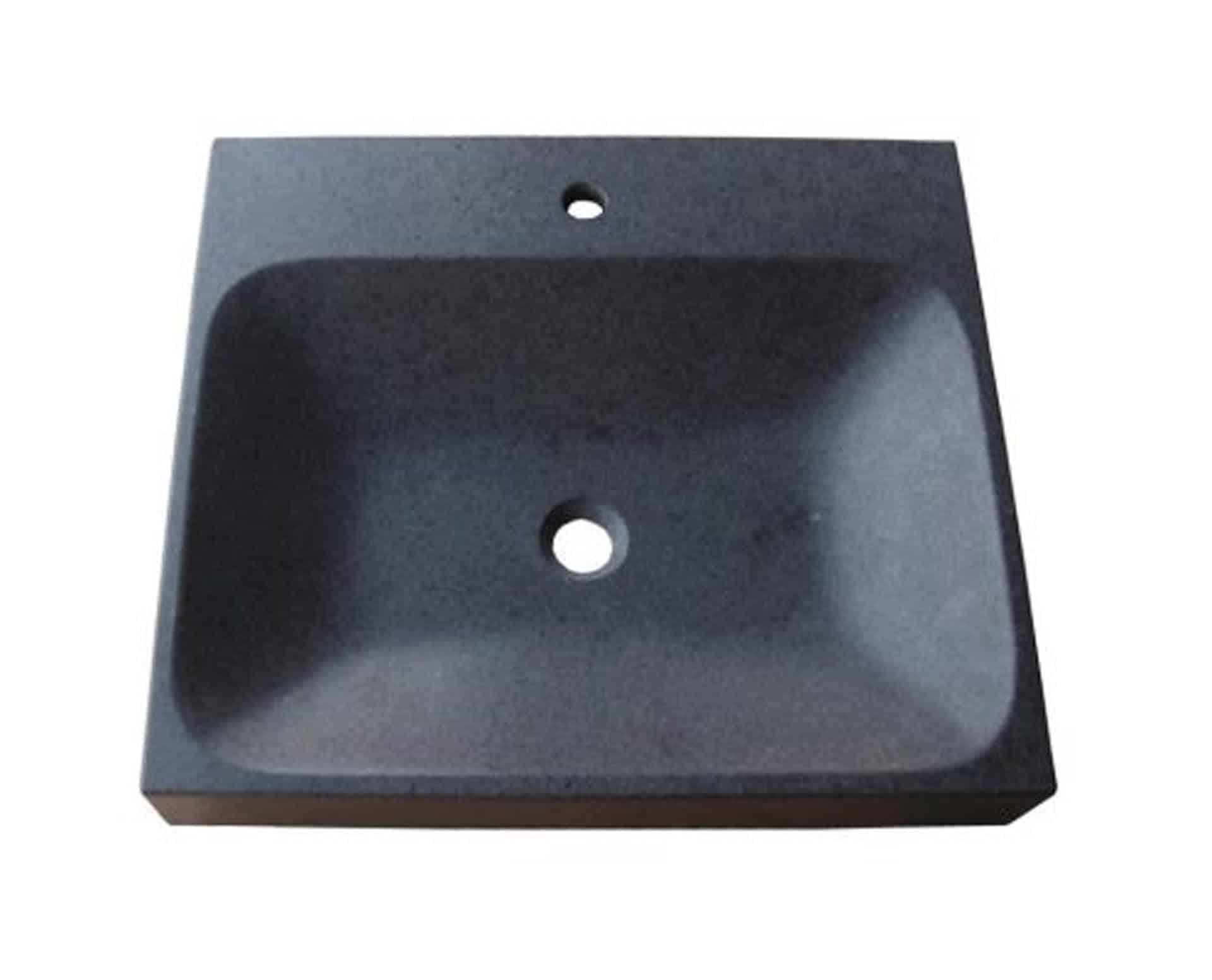Eksklusiv designhåndvask fremstillet i massiv granit. Den sorte granit har en mat finish. En ægte stenvask i målene: 61 x 54 x 9,5 cm. Vasken er bearbejdet ud af et helt stykke granit - vi fræser ganske enkelt en håndvask ud af sten. Alle de afsluttende små detaljer er håndlavet. Med denne vask vil man få et stykke natur hjem i badeværelset. Det er kvalitet, som holder mange år ud i tiden. Vasken kan bruges som fritstående vask - da vasken er flad i bunden er den velegnet til at placere direkte på en bordplade. Vasken er hensynsmæssigt designet med fine rundinger, som både giver vasken et eksklusivt udtryk og gør den rengøringsvenlig. Vasken vedligeholdes med voks - vi anbefaler en behandling med vores egen naturvoks ID12002 et par gange om året for at opnå optimalt look.