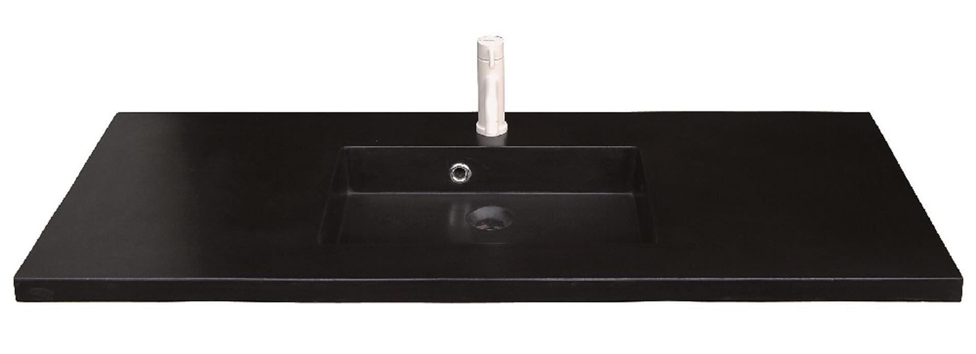 Lækker og simpel beton håndvask, med pæne afrundinger. Farven er i koksgrå - en fantastik flot og moderne betonfarve, der passer ind i ethvert badeværelse. Beton tåler ikke stærke rengøringsmidler, eller syreholdige produkter. Vi anbefaler derfor, at vasken rengøres i pH neutralt rengøringsmiddel. Vasken har målene: 120 x 60 x 3 cm. Materialet er normal beton som er blevet støbt i en form og bagefter vibreret for at få luftlommer ud af råmaterialet. Vasken skal stå på et skab. Køb et af vores tre slags åbne ophæng til slimlinevaske eller se vores guide til hvilket skab, der passer til og hvor du kan købe det. Vasken er hensynsmæssigt designet med fine rundinger, som både giver vasken et eksklusivt udtryk og gør den rengøringsvenlig. Vasken vedligeholdes med voks - vi anbefaler en behandling med vores egen naturvoks ID12002 et par gange om året for at opnå optimalt look.