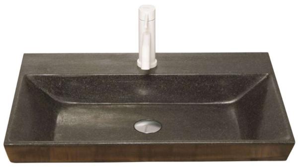 Eksklusiv designhåndvask fremstillet i massiv granit. Den sorte granit har en mat finish. En ægte stenvask i målene: 60,5 x 35,5 x 10 cm. Vasken er bearbejdet ud af et helt stykke granit - vi fræser ganske enkelt en håndvask ud af sten. Alle de afsluttende små detaljer er håndlavet. Med denne vask vil man få et stykke natur hjem i badeværelset. Det er kvalitet, som holder mange år ud i tiden. Vasken kan bruges som fritstående vask - da vasken er flad i bunden er den velegnet til at placere direkte på en bordplade. Vasken er hensynsmæssigt designet med fine rundinger, som både giver vasken et eksklusivt udtryk og gør den rengøringsvenlig. Vasken vedligeholdes med voks - vi anbefaler en behandling med vores egen naturvoks ID12002 et par gange om året for at opnå optimalt look.