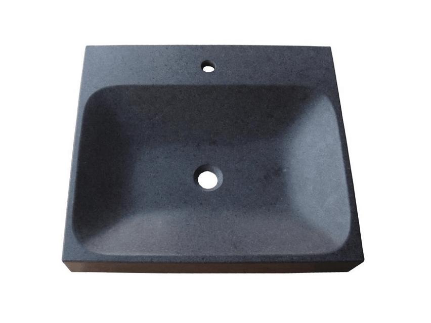 Flot håndvask skåret ud af et stykke granit